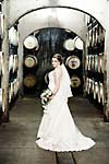 Wedding photograph of a bride in the cellar at Creekside Estate Winery in Jordan Station
