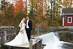 Wedding photograph of a bride and groom near a waterfall at morningstar mill