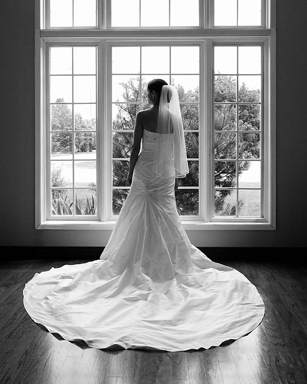 Wedding photograph of a bride in a beautiful dress in front of a window