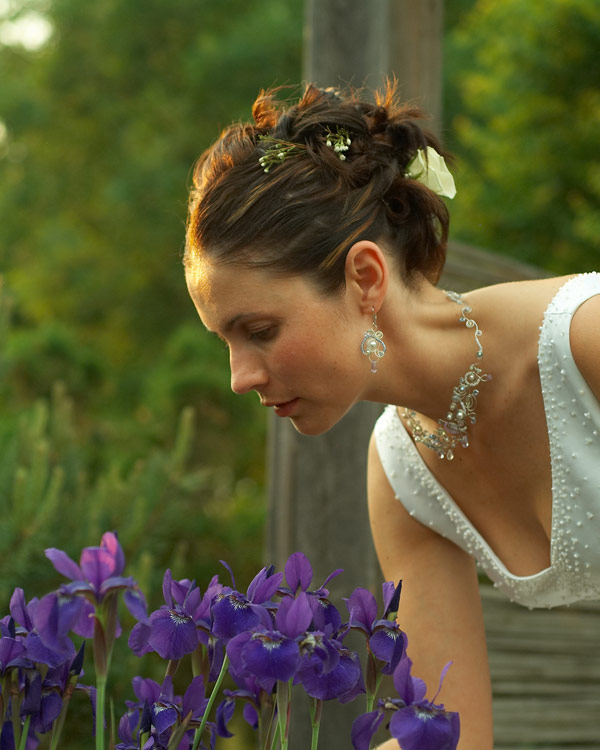 Elegant wedding photograph of bride in garden during sunset at University of Guelph