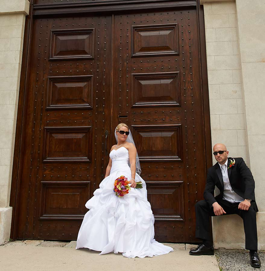 Wedding photograph of a bride and groom relaxing at Dundurn Castle in Hamilton