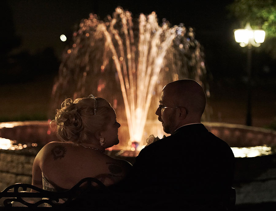 Romantic wedding night photograph of a bride and groom in front of a lit fountain at Carmens in Hamilton