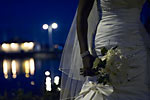 Wedding photograph of the Hamilton Waterfront at night with flowers and dress in the foreground