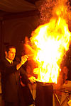 Spectacular wedding photograph of waiters preparing cherry flambe dessert with huge flames at The Olympia